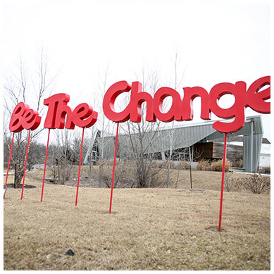 be the change sign outside of youth emergency shelter